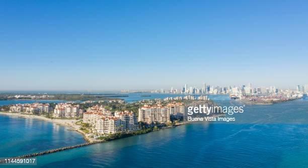 aerial view of fisher island and miami. - fisher island stock pictures, royalty-free photos & images