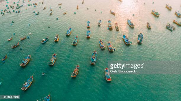 aerial view of fishermen's boats in the bay - commercial_fishing stock pictures, royalty-free photos & images