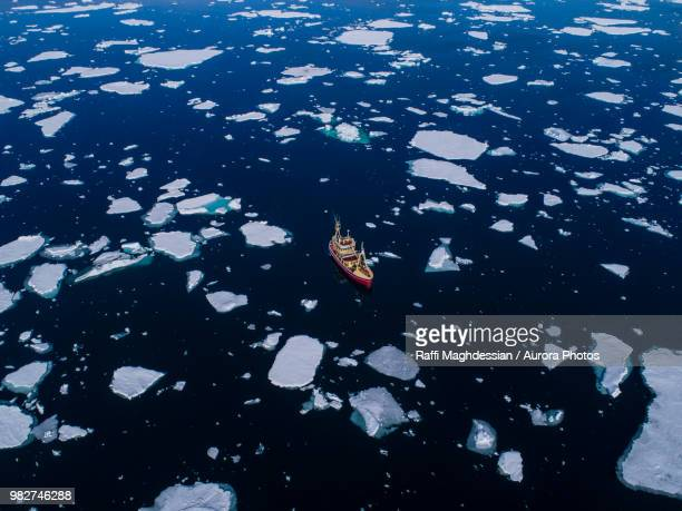 aerial view of fishing boat in waters of arctic ocean, spitsbergen, svalbard and jan mayen, norway - global warming stock pictures, royalty-free photos & images