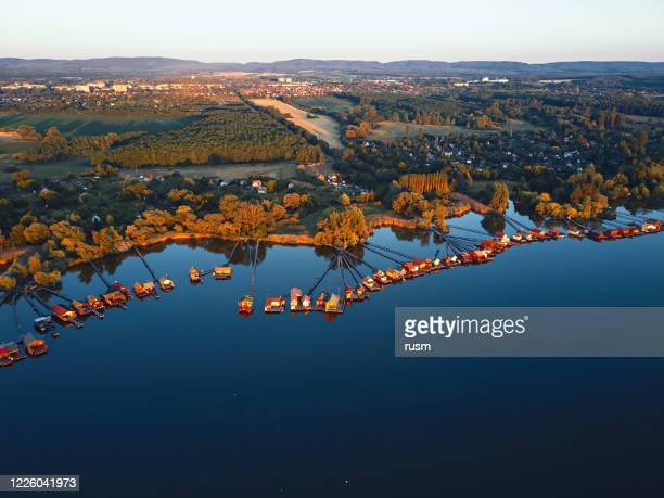 aerial view of fishing houses line on the lake shore, hungary - hungary stock pictures, royalty-free photos & images