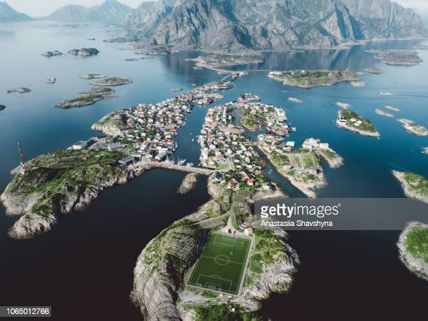 aerial view of fishing village and football field on lofoten islands in norway - lofoten stock pictures, royalty-free photos & images