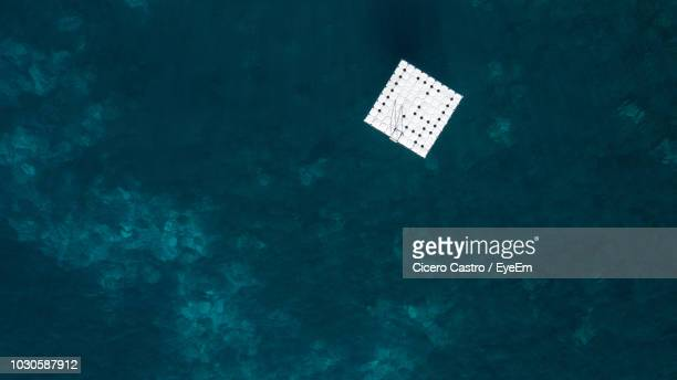 aerial view of floating platform in sea - diving platform stock pictures, royalty-free photos & images