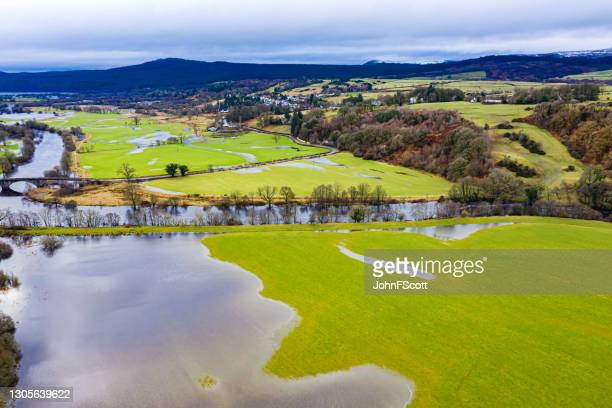 aerial view of flooded fields after heavy rain - johnfscott stock pictures, royalty-free photos & images
