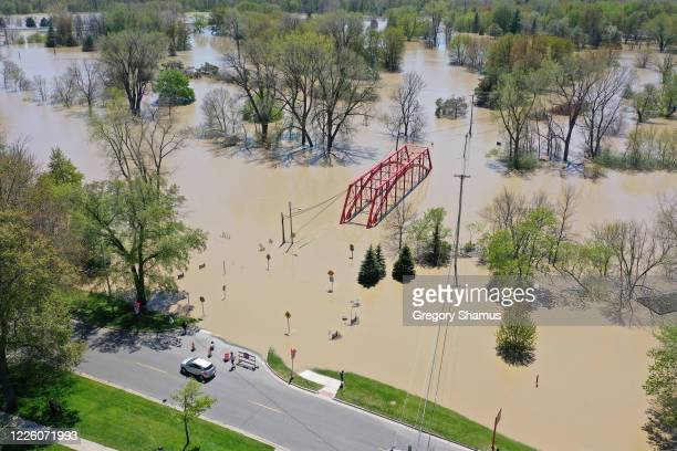 A aerial view of floodwaters flowing from the Tittabawassee River into the lower part of downtown Midland on May 20 2020 in Midland Michigan...