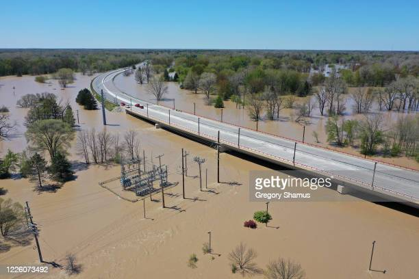Aerial view of floodwaters flowing from the Tittabawassee River into the lower part of downtown Midland on May 20, 2020 in Midland, Michigan....