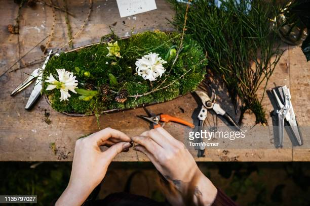 aerial view of florist making floral display - flower arrangement stock pictures, royalty-free photos & images