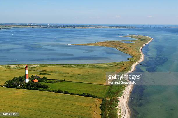 aerial view of flugger lighthouse and baltic sea. - fehmarn stock-fotos und bilder