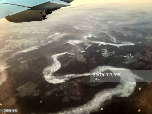 Aerial view of fog moving through valleys
