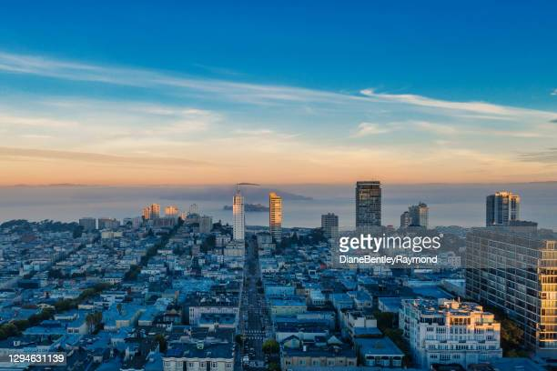 aerial view of fog over san francisco bay - north beach san francisco stock pictures, royalty-free photos & images