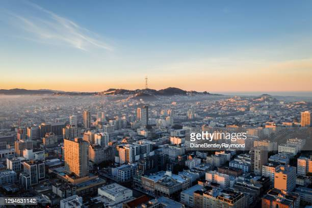 aerial view of fog over san francisco skyline - san francisco california stock pictures, royalty-free photos & images