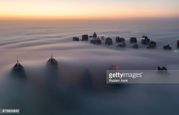 A aerial view of Foggy Morning of Dubai marina captured from 73rd floor of cayan tower on December 05 2016 in Dubai United Arab Emirates
