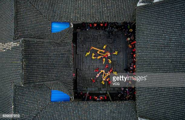 Aerial view of folk artists performing dragon dance at Miaoxiagu Village on January 21 2017 in Chenzhou Hunan Province of China Chinese people...