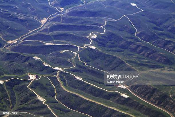 Aerial view of fracking wells that follow mountain ridges in Colorado. Shot June 26, 2011.