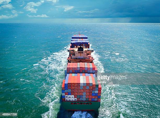 aerial view of freight ship with cargo containers - boat stock pictures, royalty-free photos & images
