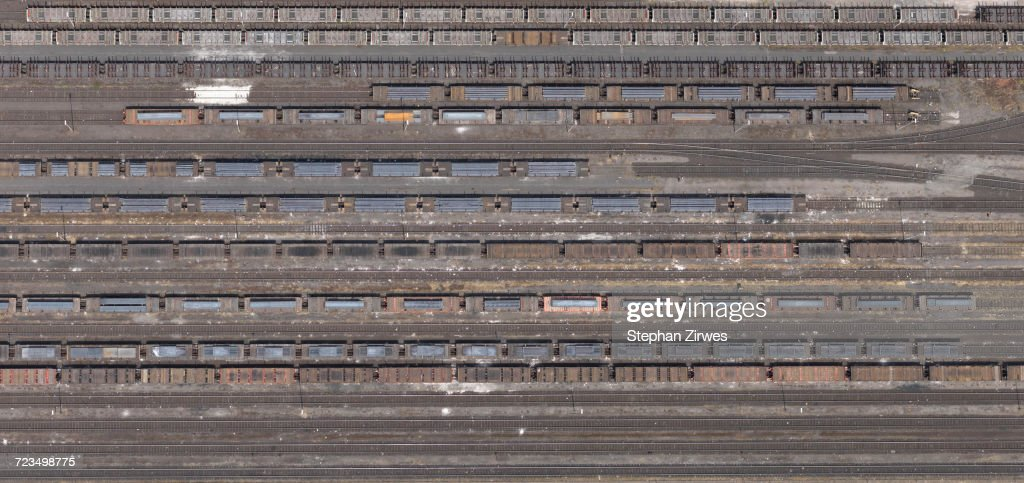 aerial-view-of-freight-train-carriages-and-tracks-north-germany-picture-id723498775