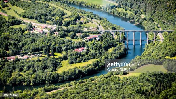 aerial view of french ain river valley in curve shape with beautiful old stone viaduct of cize-bolozon in bugey mountains - rhone alpes stock photos and pictures
