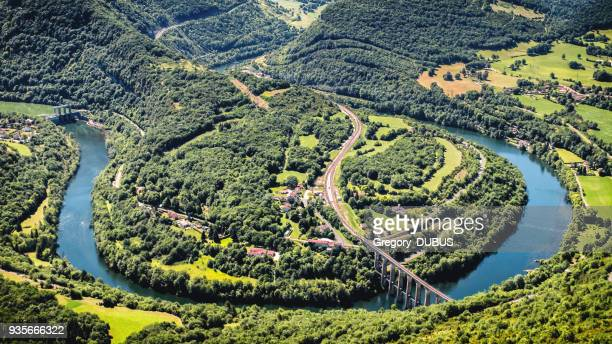 aerial view of french ain river valley in horseshoe shape with beautiful old stone viaduct of cize-bolozon in bugey mountains - rhone alpes stock photos and pictures