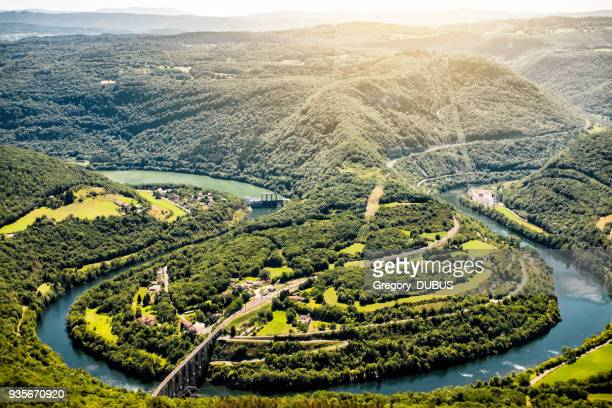 aerial view of french ain river valley in horseshoe shape with beautiful old stone viaduct of cize-bolozon in bugey mountains - auvergne rhône alpes stock pictures, royalty-free photos & images