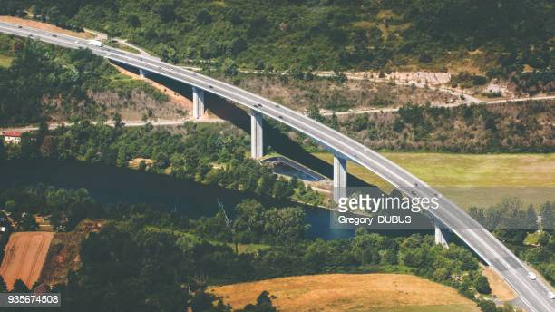 aerial view of french curved elevated highway road crossing wild ain river in summer season - ain france stock pictures, royalty-free photos & images
