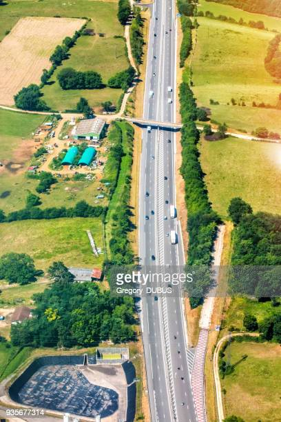 aerial view of french highway road crossing lush foliage countryside in summer season - ain france stock pictures, royalty-free photos & images