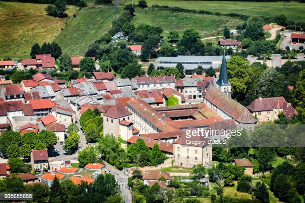 aerial view of french village of ambronay in ain countryside with famous abbey and church in summer season - abby road stock photos and pictures