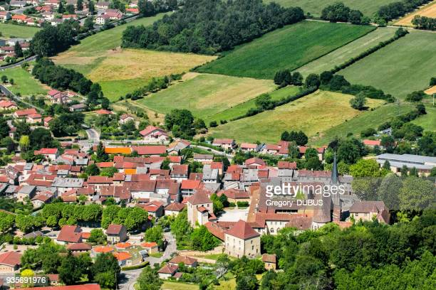 aerial view of french village of ambronay in ain countryside with famous abbey and church in summer season - ain france stock pictures, royalty-free photos & images
