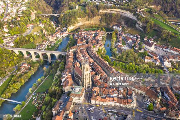 aerial view of fribourg medieval old town with its gothic cathedral in switzerland - フリブール州 ストックフォトと画像