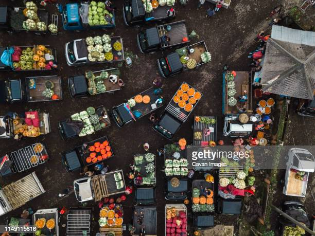 aerial view of fruit market - marktplatz stock-fotos und bilder