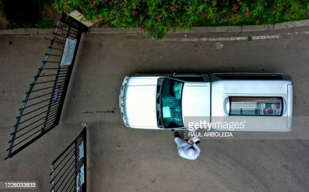 Aerial view of funeral parlour workers transporting the coffin of a COVID19 victim to be cremated at Serafin cemetery in Bogota on July 10 2020 From...