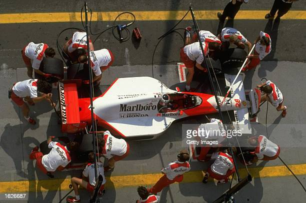 Aerial view of Gerhard Berger of Austria in his McLaren Honda during a pit stop at the Hungarian Grand Prix at the Hungaroring circuit in Budapest,...