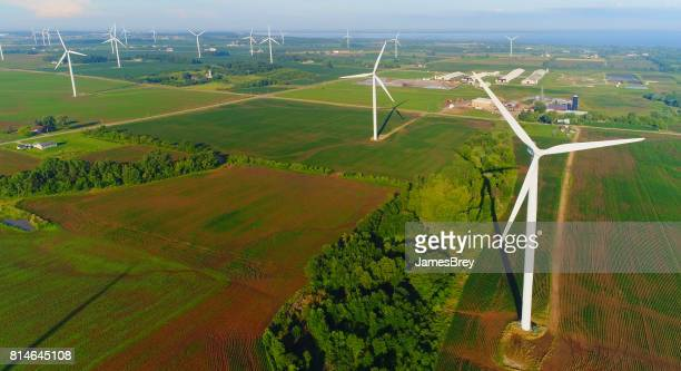 aerial view of giant wind turbines turning in wind. - dramatic landscape stock pictures, royalty-free photos & images