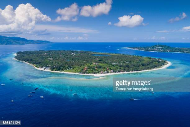 aerial view of gili trawangan island with clear blue sky in lombok, indonesia - gili trawangan stock photos and pictures