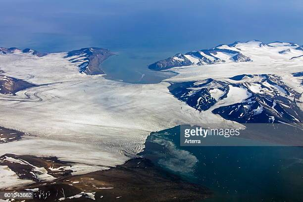 Aerial view of glacier breaking up in sea at Spitsbergen / Svalbard Norway