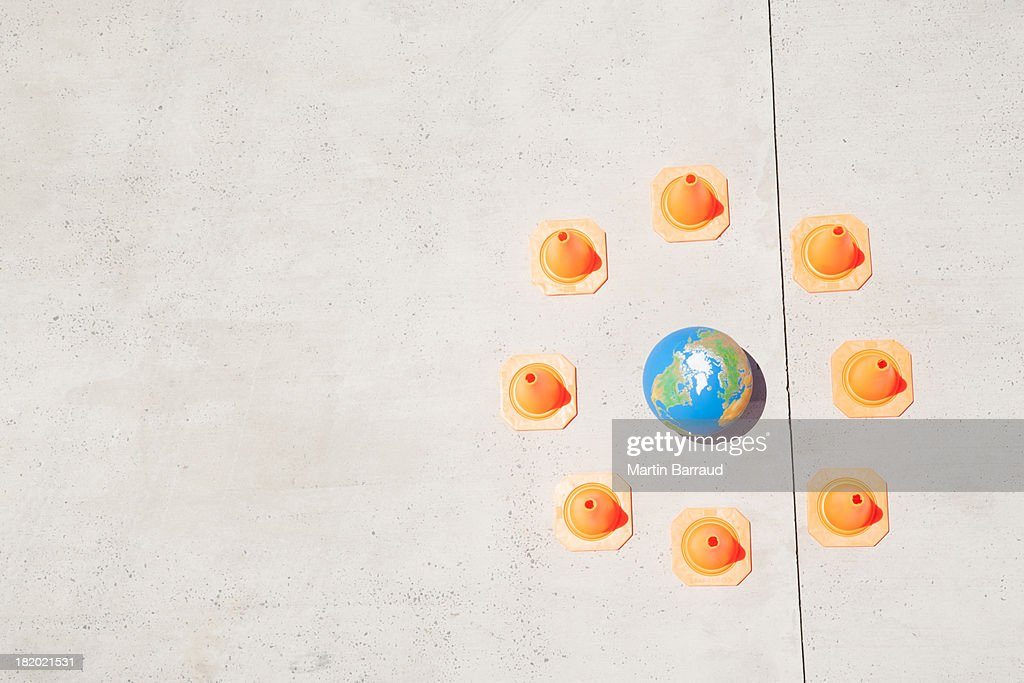 Aerial View of globe with safety cones : Stock Photo