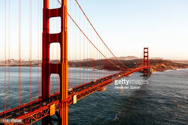 aerial view of golden gate bridge at sunset, san fransisco, california, usa - san francisco kalifornien bildbanksfoton och bilder
