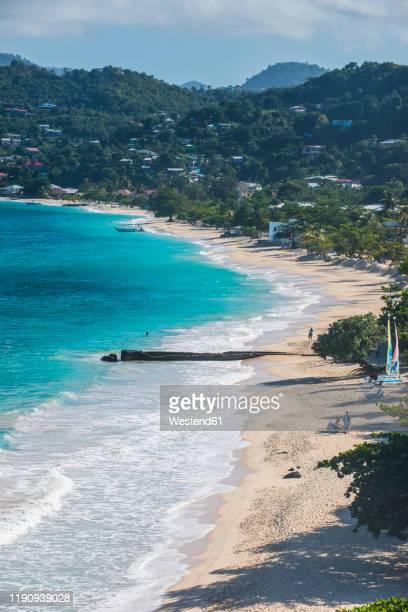 aerial view of grand anse beach against mountain, grenada, caribbean - paisajes de isla de  granada fotografías e imágenes de stock