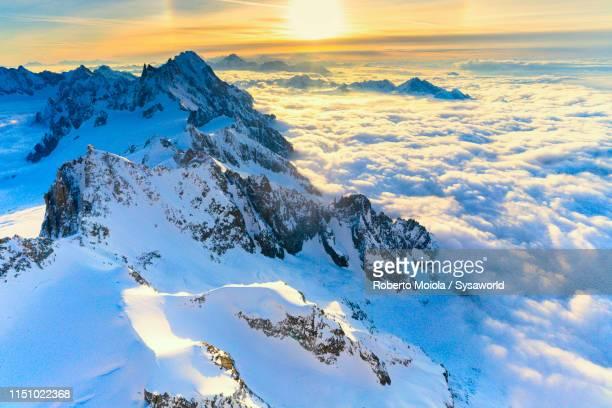 aerial view of grand jorasses and dent du geant, italy - alpes européennes photos et images de collection