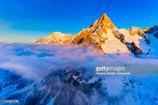 aerial view of grandes jorasses and mont blanc, italy - 岩壁 ストックフォトと画像