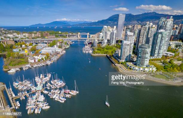 aerial view of granville island & downtown vancouver, british columbia, canada - vancouver stock pictures, royalty-free photos & images