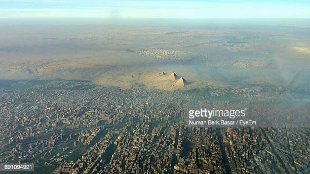aerial view of great pyramid of giza and cityscape - giza pyramids stock pictures, royalty-free photos & images