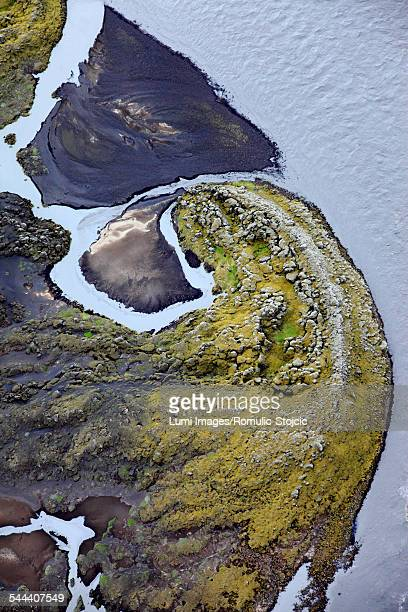 Aerial view of green coastline and frozen water, Landmannalaugar, Iceland