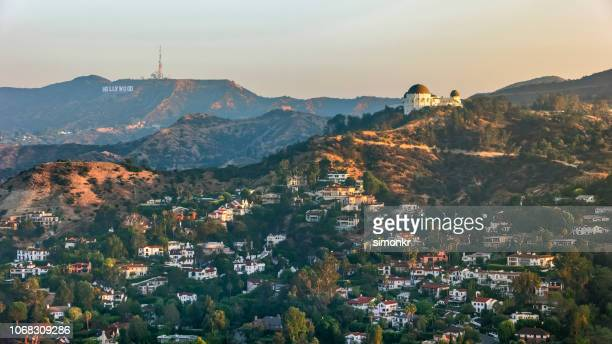 aerial view of griffith observatory with the hollywood sign seen in the distance - los angeles foto e immagini stock