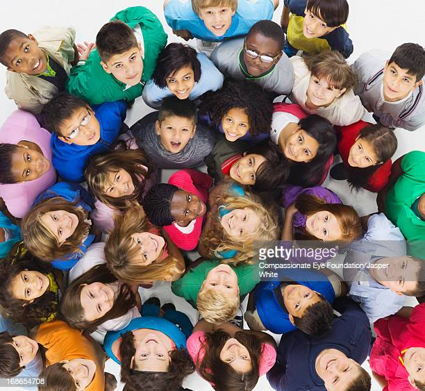 aerial view of group of smiling children - etnia foto e immagini stock