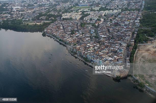 Aerial view of Guanabara bay at the border of Favela da Maré , water pollution, Rio de Janeiro.