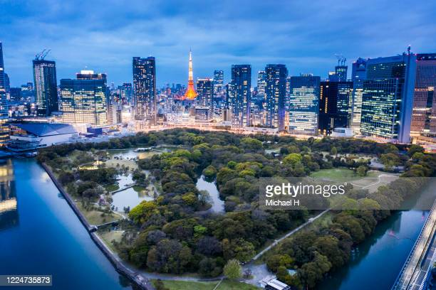 aerial view of hamarikyu gardens and tokyo tower - japan stock pictures, royalty-free photos & images