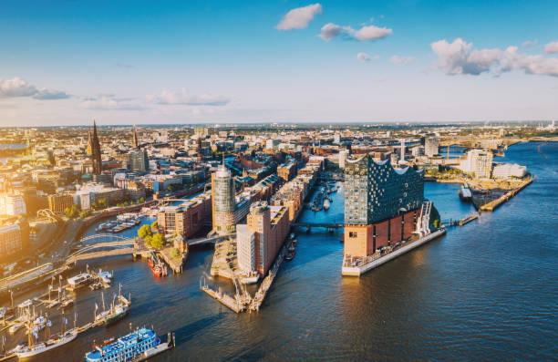 aerial view of hamburg hafen city over blue harbour - germany stock pictures, royalty-free photos & images