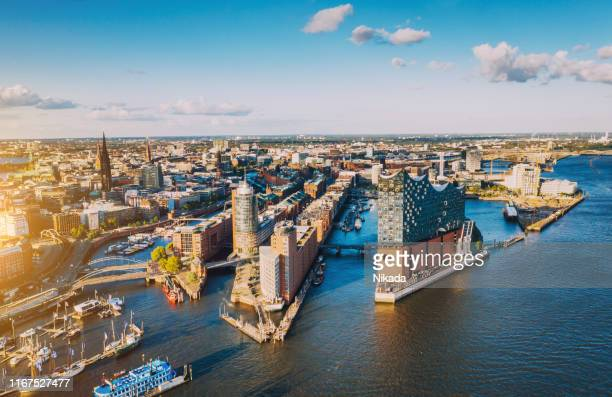 aerial view of hamburg hafen city over blue harbour - hamburg germany stock pictures, royalty-free photos & images
