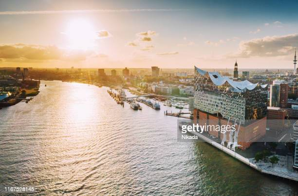 aerial view of hamburg hafen city over blue harbour - elbphilharmonie stock pictures, royalty-free photos & images