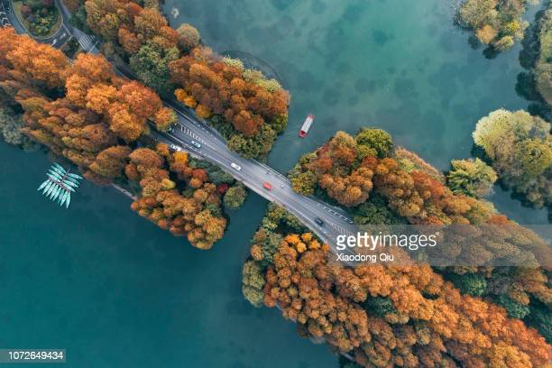 aerial view of hanghzou yanggong levve at dusk - hangzhou stock pictures, royalty-free photos & images