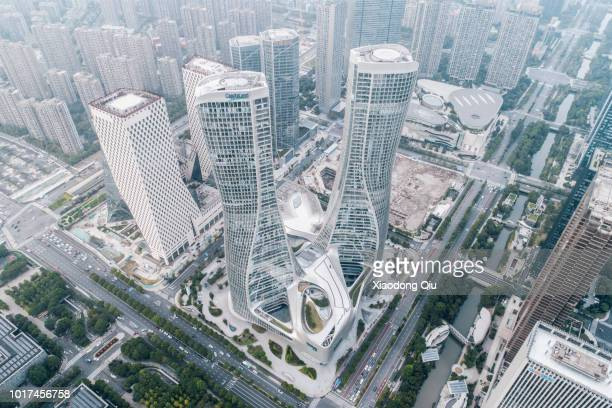 aerial view of hangzhou raffles city at dusk - hangzhou stock photos and pictures